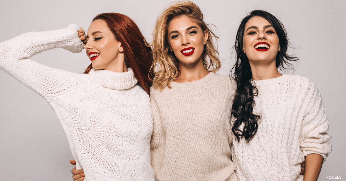 Women smiling after facial fillers