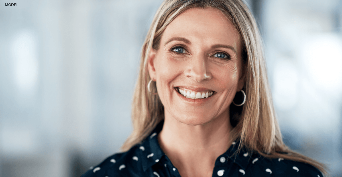 Woman smiling after fully recovering from a facelift