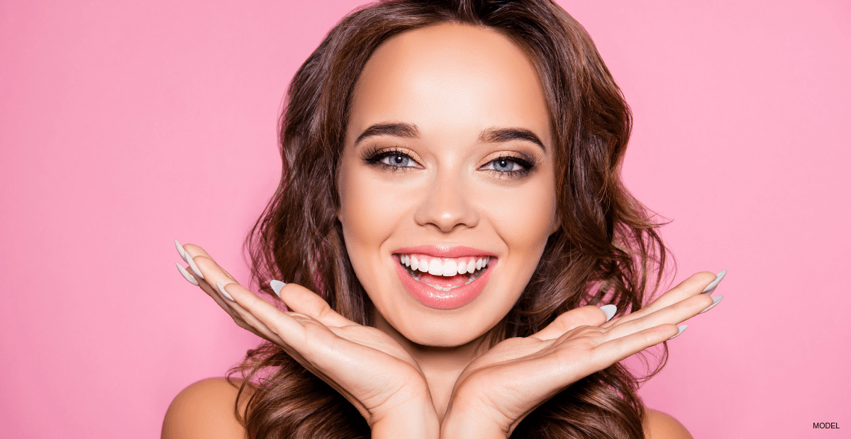 Woman smiling after BOTOX cosmetic with Dr. Otto Weiglein