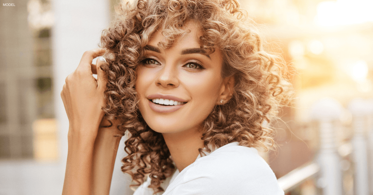 Woman smiling after receiving Sculptra® treatments in Burlington, ON